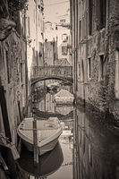 Canal in Venice with bridge and boats