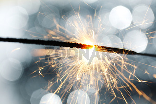 sparkler on silver bokeh background macro close up