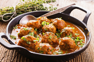meatballs cooked with herbs