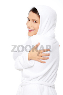 Young beautiful happy woman in bathrobe