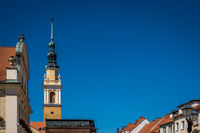 Horizontal shot of an ancient church tower in Poland