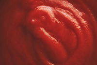 Tomato sauce extreme close up shot.