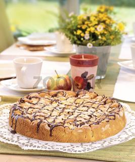 Apple cake on tea table