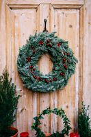 Christmas wreath of fir branches on a wooden door.
