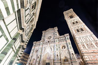 Italy, Florence by night. The  illuminated architecture of the cathedral exterior.