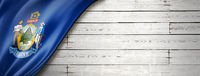 Maine flag on white wood wall banner, USA