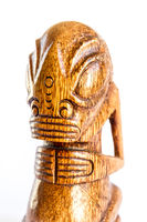 traditional wooden Polynesian tiki from Marquesas Islands. White background