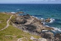 ST IVES, CORNWALL, UK - MAY 13 : Coastal walk near Porthgwidden beach at St Ives, Cornwall on May 13, 2021. Unidentified people