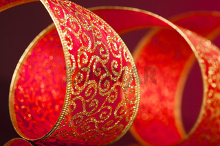 red and golden bow on background