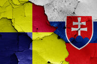 flags of Kosice Region and Slovakia painted on cracked wall