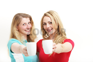 Happy women toasting with coffee