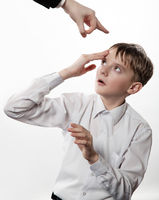 Boy rubs a forehead after blow