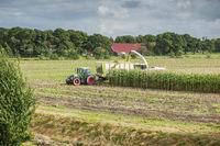 Corn harvest vehicles distant view phase 1
