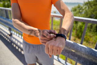 close up of man with fitness tracker outdoors