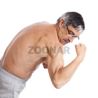 Senior man showing biceps