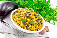 Bulgur with eggplant in bowl on light board