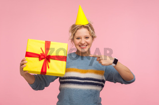 Portrait of emotional blonde woman on pink background.
