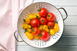 various tomatoes in colander