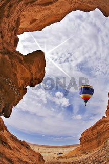 The balloon flies above slot-hole canyon