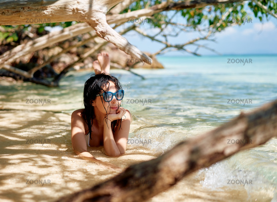 Beautiful happy woman relax in tropical beach lagoon enjoying summer vacation