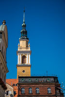 Vertical shot of an ancient church tower in Poland