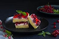 Delicious berries cake with cream filling. Dark mood.