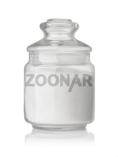 Front view of  refined granulated sugar in glass jar