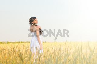 Woman on wheat field