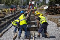 Workers install tram rails