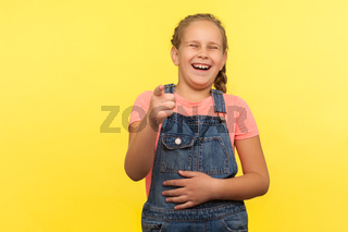 portrait of beautiful little girl standing on yellow background.