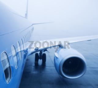 airplaine exterior close up, fog