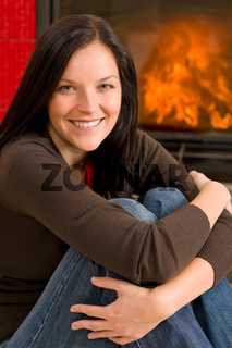 Home fireplace happy woman relax warm up