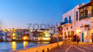 he Little Venice in Mykonos at dusk