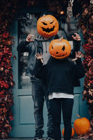 Couple with pumpkin heads scares passers-by at the camera