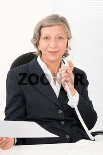 Senior businesswoman on phone hold empty sheet