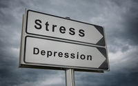 Stress Depression road sign on background of dark clouds.