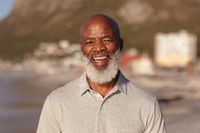 Portrait of senior african american man smiling while standing on the beach