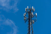 Cell phone or mobile service tower providing broadband internet service against blue sky