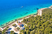 Island of Vir archipelago lighthouse and beach aerial panoramic view