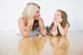 Resting mother and daughter on the floor