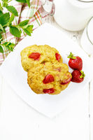 Scones with strawberry in plate on light board top