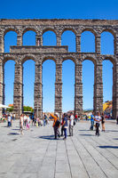 Aqueduct in Segovia and people in Plaza Azoguejo