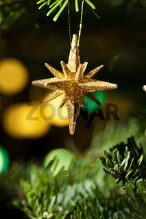 Gold Stern als Weihnachtsbaumdekoration