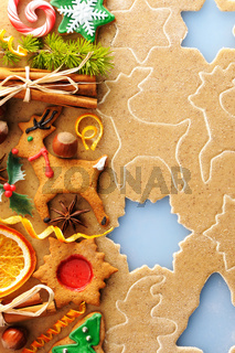 Christmas spices and cookies over gingerbread dough