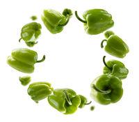 Green paprika levitates on a white background