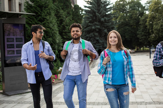 Group of high school students talking and laughing