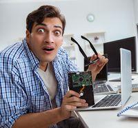 Technician with broken hard drive