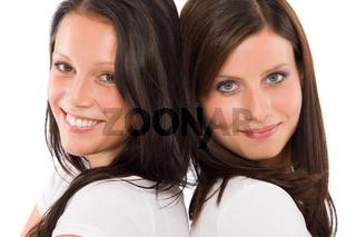 Two girlfriends beautiful model smiling portrait