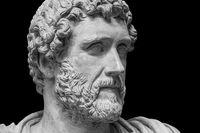 Portrait of Roman emperor Antoninus Pius isolated on a black background. Old beard man sculpture