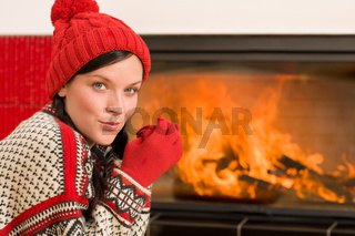 Fireplace warming up happy woman winter home
